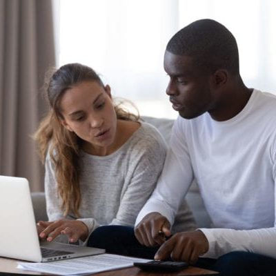 man and woman looking at documents