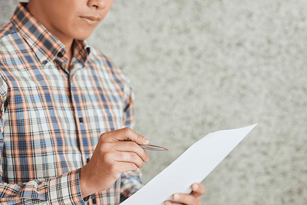 entrepreneur-checking-business-document-LYMT258_sm